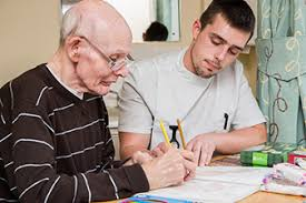 ealth and social care apprenticeships helping elderly man write