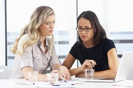 two women talking in a meeting