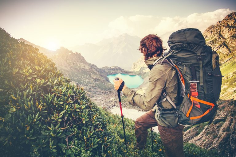 backpacker hiking in mountains
