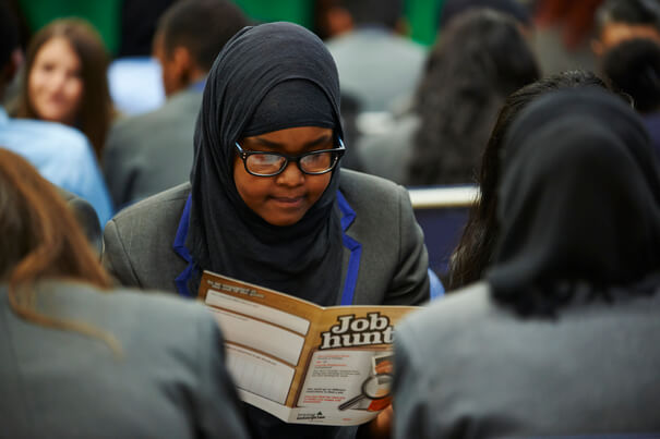 Young Enterprise, lady looking at book with title job hunt