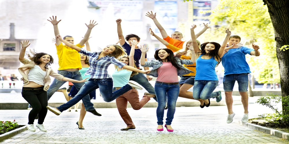 Happy young students jumping the air with joy