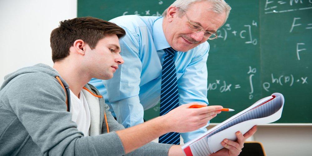 teacher teaching a young student