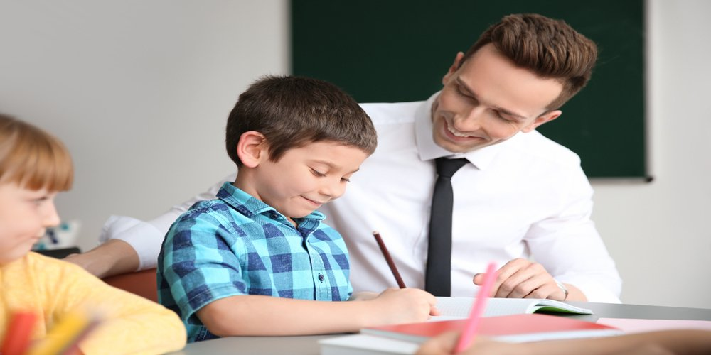 a man who has become a teacher helping student