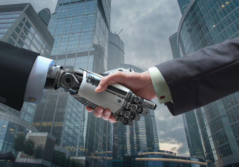 robot and human shaking hands in business