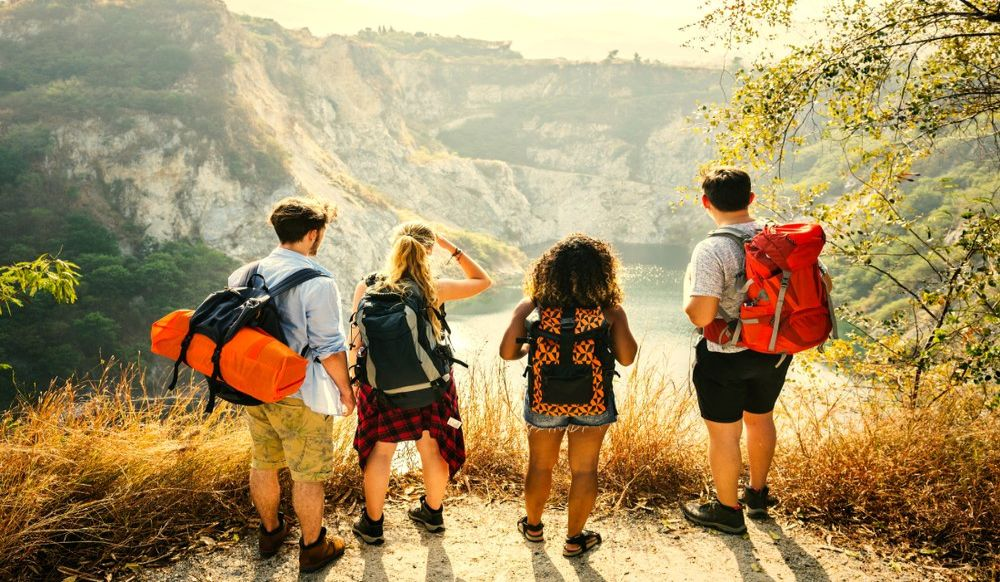 Young group of friends with backpacks