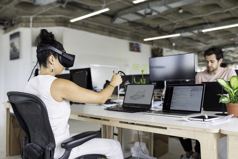 Woman using Virtual Reality (VR) for work enginerering