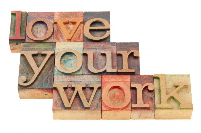 Love your work motivational suggestion in vintage wood letterpress printing blocks, isolated on white
