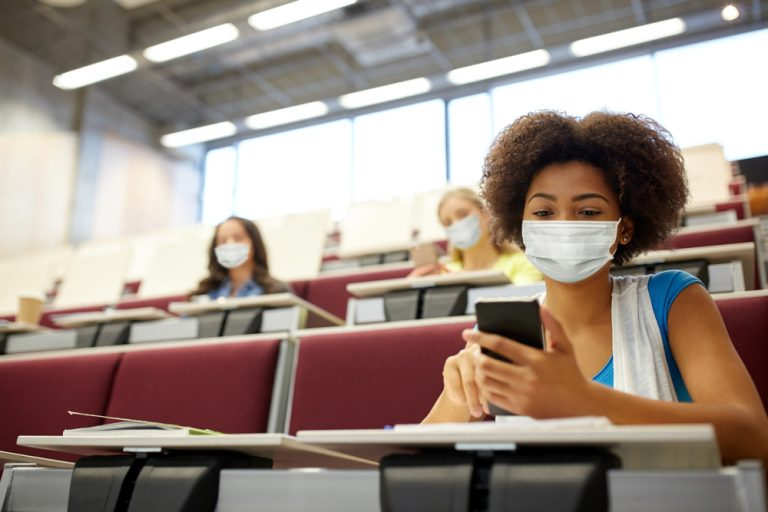 Masked students in lecture theatre