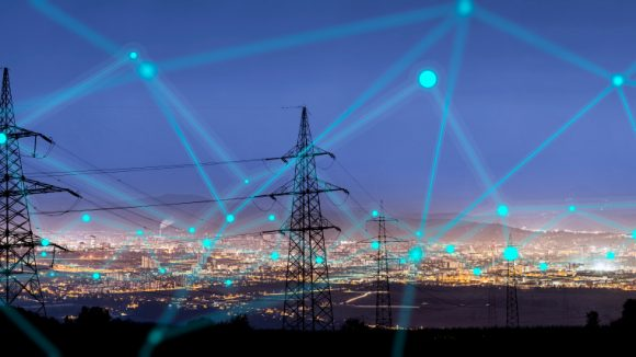 Electrical pylons in night sky