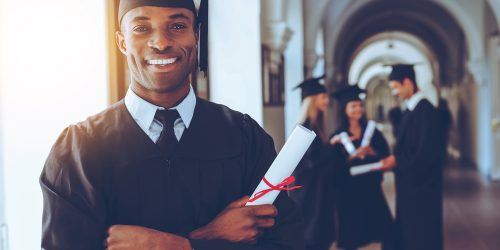 Happy graduate. Happy African man in graduation gowns. thinking of graduate scheme.